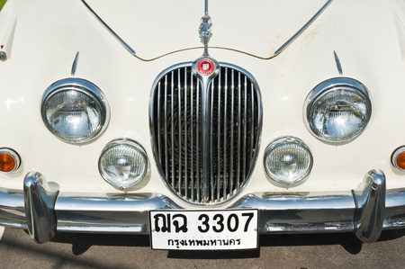 HUA HIN, THAILAND - DEC 16: A 1964 Jaguar 3.4 Mk2 on display in Hua Hin Vintage Cars Parade Festival 2011 at Hua Hin floating market on December 16, 2011 in Hua Hin, Thailand.