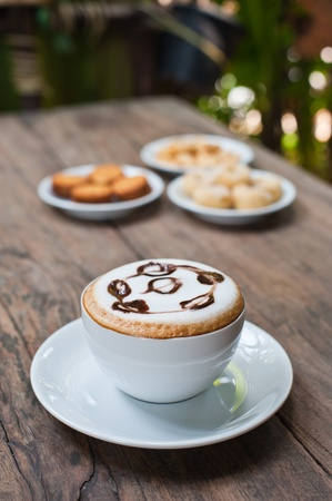 coffee cup with snack on wood table Stock Photo - 13596692
