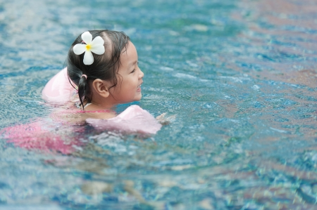 armbands: Little girl swimming in pool