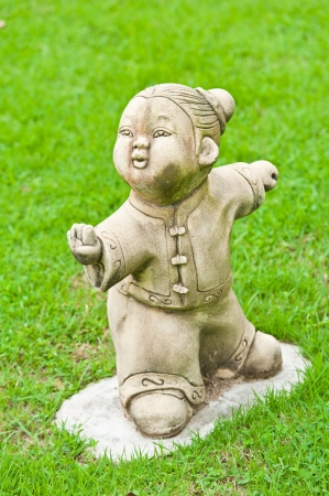 Chinese statue in the temple with grass photo