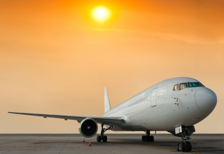 Commercial airplane parking at the airport photo