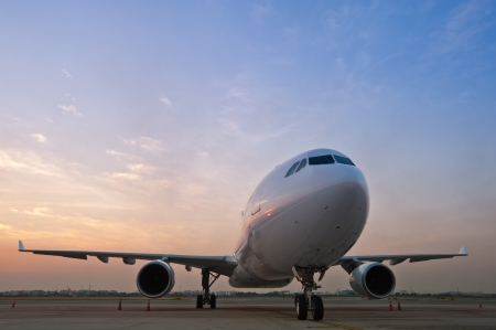 Commercial airplane parking at the airport Stock Photo - 14145386