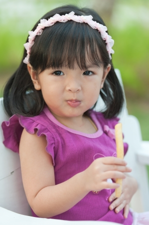 Little girl eating french fries photo