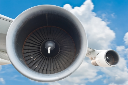 aircraft engine: Close-up of a passenger airplane in the sky
