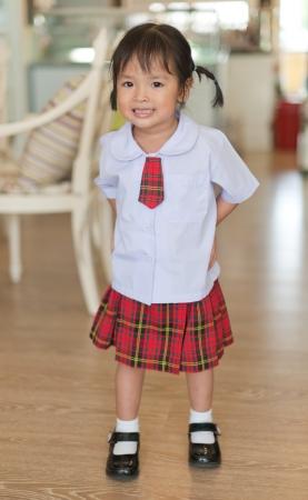 primary color: Little asian schoolgirl