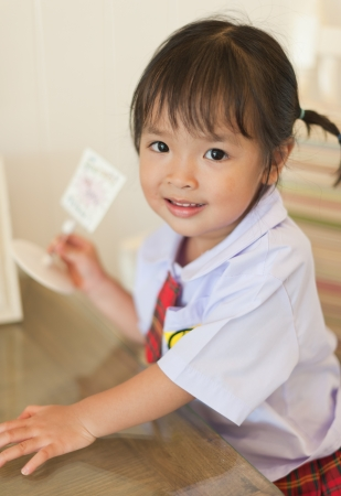 uniform skirt: Little asian schoolgirl
