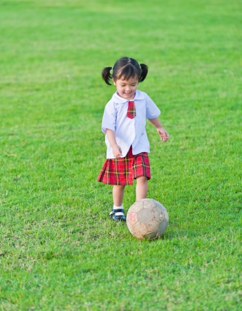 girl kick: Little girl soccer player Stock Photo