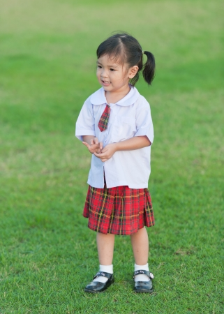 asian little girl at soccer field photo