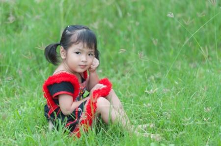 Little asian girl on grass Stock Photo - 14382004