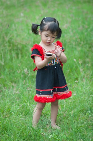 Little asian girl with mobile phone photo