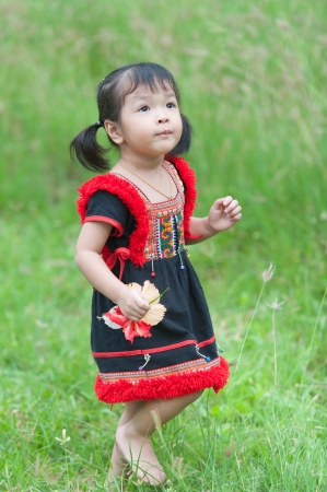 Little asian girl with beautiful flower photo