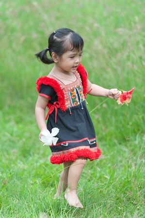 Little asian girl with beautiful flower Stock Photo - 14381854