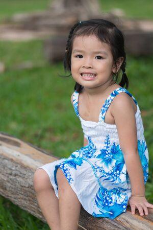 Little asian girl in a garden photo