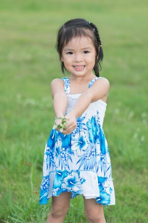 Little asian girl in a garden photo