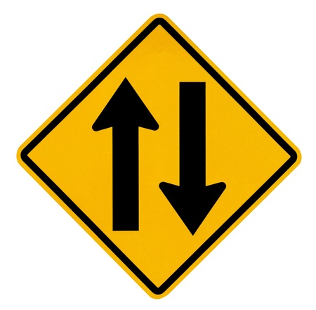 Two way traffic sign on white background photo