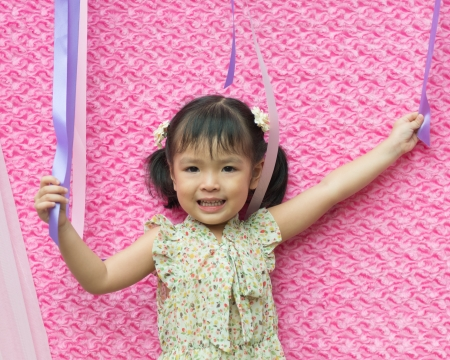 Portrait of little Asian girl on pink Stock Photo - 15796764