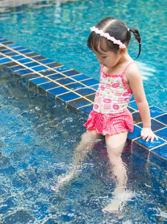 little girl smiling: Little girl swimming in pool