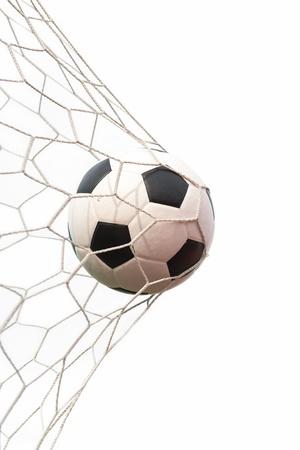 soccer ball: soccer ball in net on white