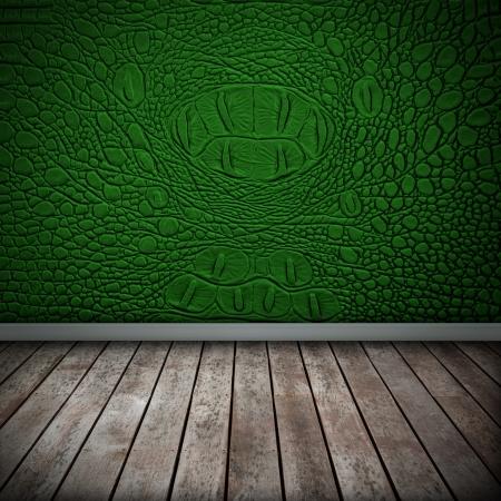 Crocodile green wall with wood floor texture interior photo
