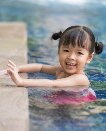 asia nature: little girl playing in swimming pool Stock Photo