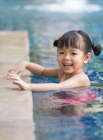 asian sport: little girl playing in swimming pool Stock Photo