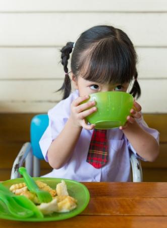 little girl have lunch at restaurant Standard-Bild