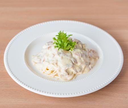 pasta fork: spaghetti carbonara with ham and cheese Stock Photo
