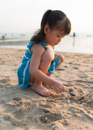 beach blond hair: Little cute girl on the beach