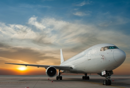runway: Commercial airplane with sunset
