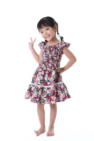 full length of asian little girl standing, isolated on white Stockfoto