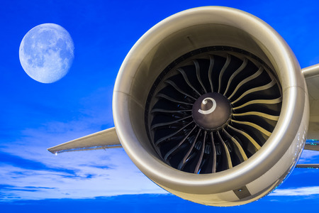 chamber of the engine: jet engine with full moon at twilight sky Stock Photo
