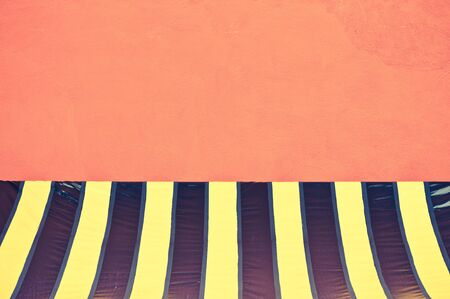 background color: colorful plastic tent at orange wall - retro vintage filter effect