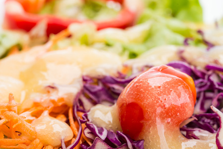 Fresh salad with dressing close-up