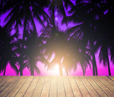 wooden floor with coconuts silhouettes with tropical sunset