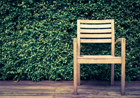 chair in a garden on wood floor, retro vintage filter effect