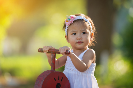 little girl at the park with playground