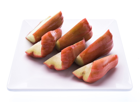 Rose apples or Chomphu slices on dish on white background