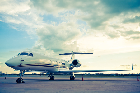 luxuries: Airplane for business flights - retro vintage filter effect