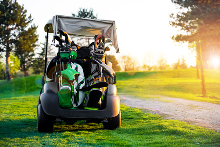 Golf carts in the green Stock Photo - 75667404