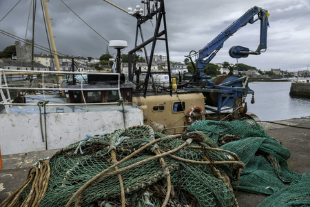 northern ireland: Fishing nets and ropes on the quay, Harbor Ardglass, County Down, Northern Ireland Stock Photo