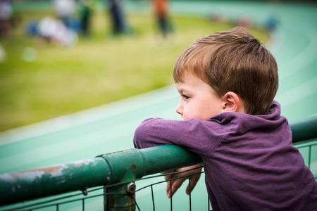 Child watching sports game in stadium