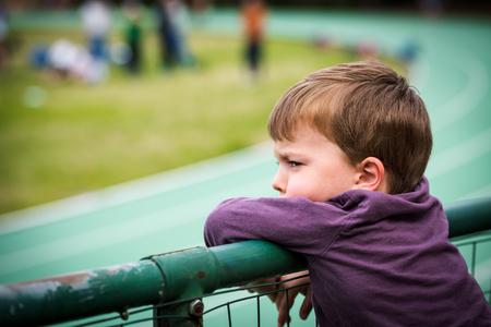 Portrait of child watching sports game in stadium