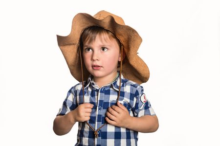 Child wearing cowboy costume watching attentive in a white isolated background Stock Photo - 78509121