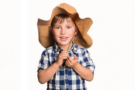 Child wearing cowboy hat, white isolated background Stock Photo