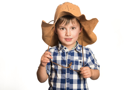Cute child wearing a cowboy hat and looking at camera Stock Photo