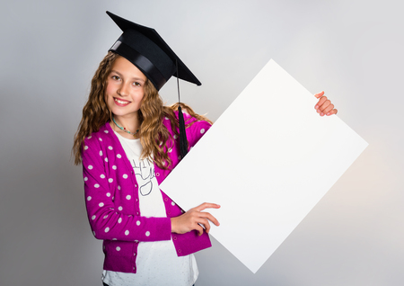 Education and school concept - cute student girl holding white board Stock Photo