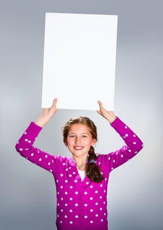 Happy girl holding white board