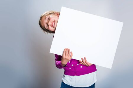 Teenager posing with a white board