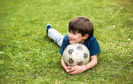 Young boy with a soccer ball