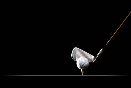 Golf ball on the tee on plain black background